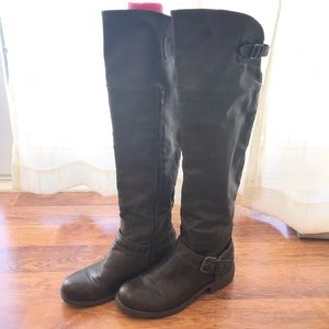 Brown leather over the knee boots.